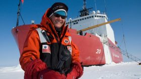 Elizabeth Arnold in Alaska in front of an ice cutter