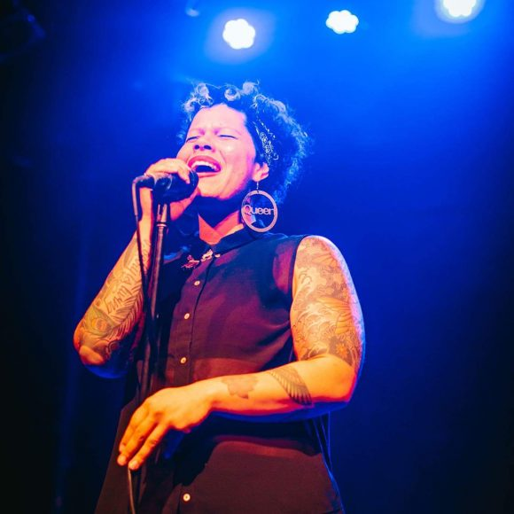 Nikkita Oliver performing on stage