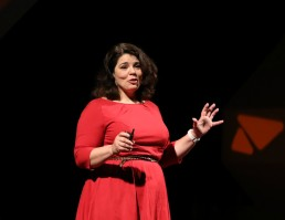 TEDxSeattle speaker Celeste Headlee on stage