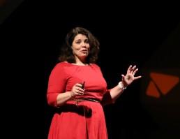 TEDxSeattle speaker Celeste Headlee on stage