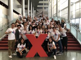 2017 TEDxSeattle volunteers gathered on the grand stairway in McCaw Hall