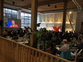 Looking from the back of the audience during TEDxSeattleLive 2018 held at The Riveter